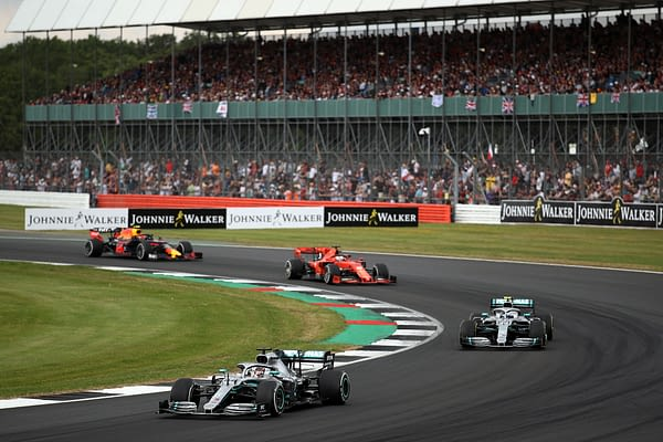 NORTHAMPTON, ENGLAND - JULY 14: Lewis Hamilton of Great Britain driving the (44) Mercedes AMG Petronas F1 Team Mercedes W10 leads Valtteri Bottas driving the (77) Mercedes AMG Petronas F1 Team Mercedes W10 on track during the F1 Grand Prix of Great Britain at Silverstone on July 14, 2019 in Northampton, England. (Photo by Bryn Lennon/Getty Images)