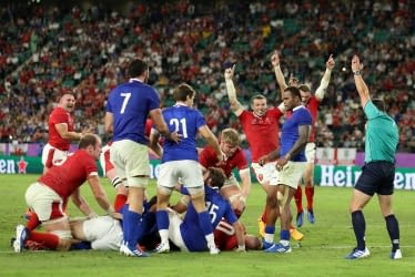 OITA, JAPAN - OCTOBER 20: Hadleigh Parkes of Wales celebrates as Ross Moriarty of Wales (obscure) scores his sides second try during the Rugby World Cup 2019 Quarter Final match between Wales and France at Oita Stadium on October 20, 2019 in Oita, Japan. (Photo by Shaun Botterill/Getty Images)