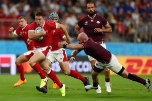 TOYOTA, JAPAN - SEPTEMBER 23: Josh Adams of Wales on the way to scoring his sides third try during the Rugby World Cup 2019 Group D game between Wales and Georgia at City of Toyota Stadium on September 23, 2019 in Toyota, Aichi, Japan. (Photo by Francois Nel - World Rugby/World Rugby via Getty Images)